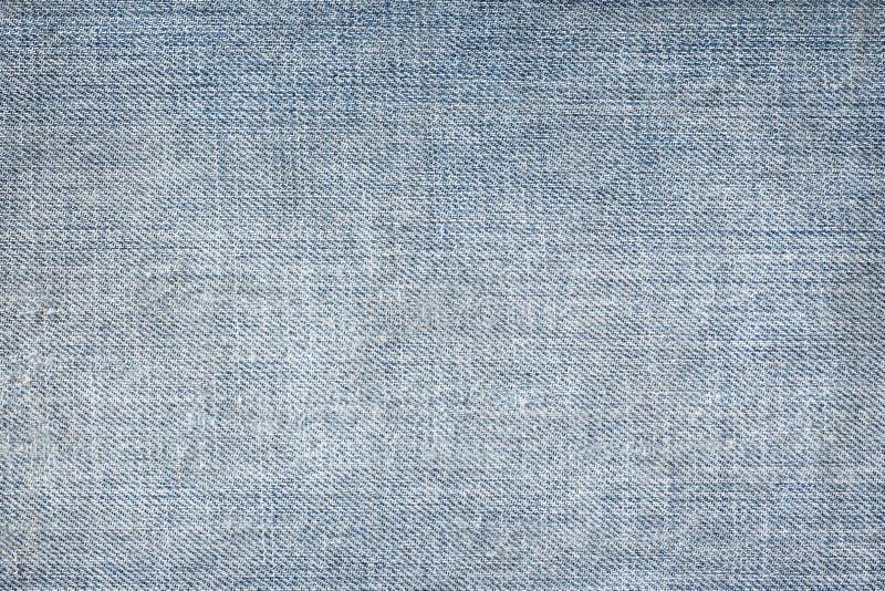 Struttura delle blue jeans senza cuciture, panno del dettaglio di denim per il modello e fondo, fine su fotografia stock