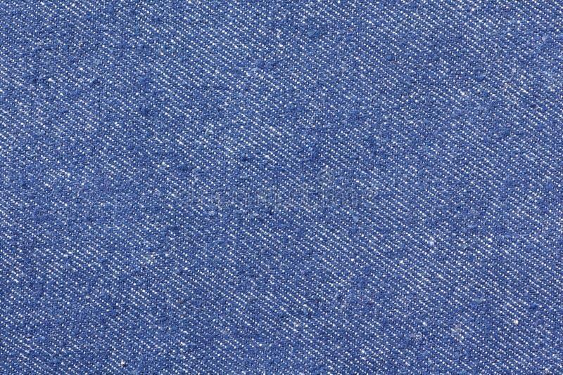 Struttura delle blue jeans senza cuciture, panno del dettaglio di denim per il modello e fondo, fine su fotografia stock libera da diritti