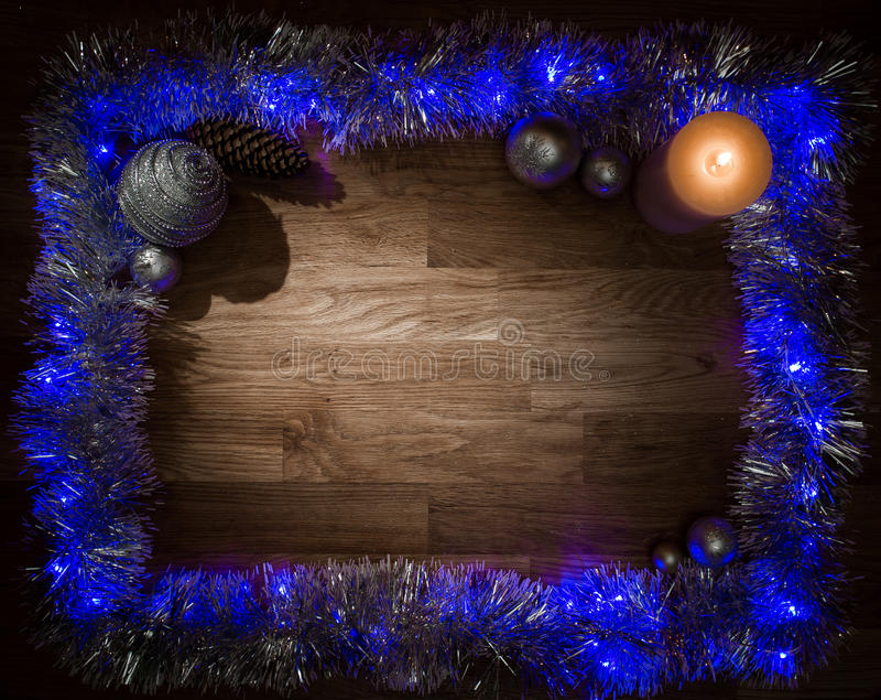 Struttura delle decorazioni di Natale con la luce della candela fotografia stock