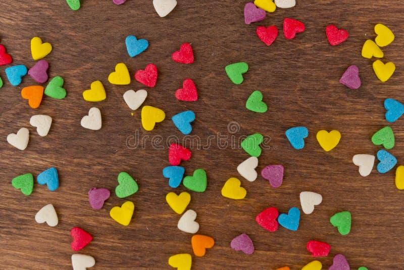 Struttura delle decorazioni variopinte dolci della caramella sotto forma di cuore fotografia stock
