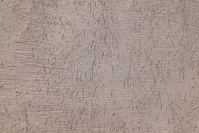 Struttura dello stucco usata come rivestimento esteriore su una costruzione fotografia stock