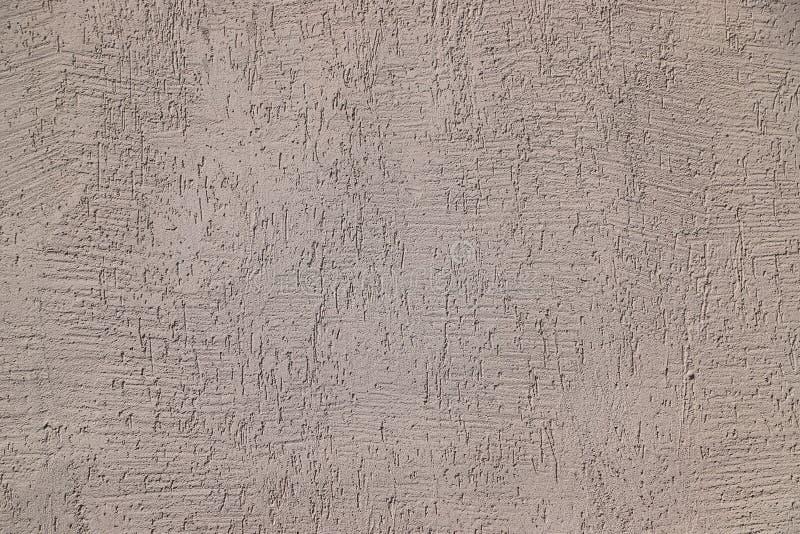 Struttura dello stucco usata come rivestimento esteriore su una costruzione fotografia stock libera da diritti