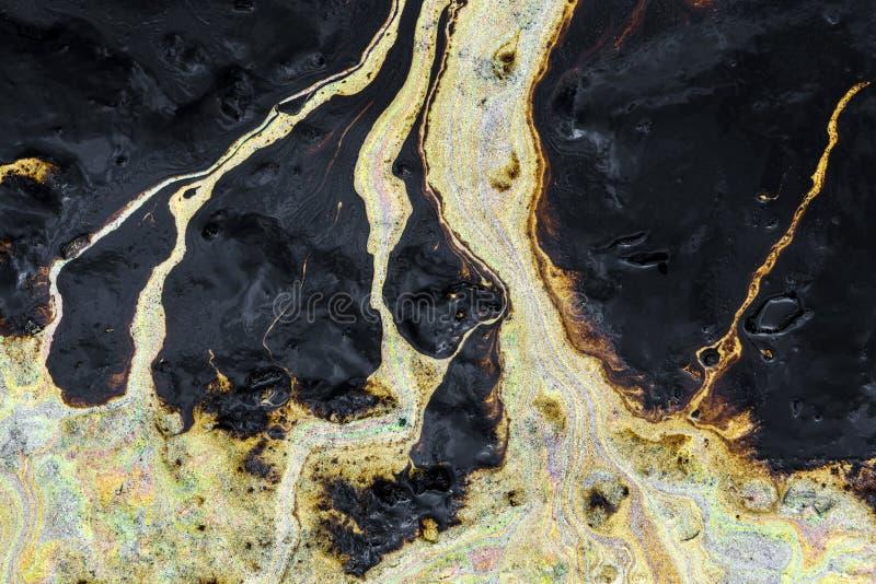 Struttura di caduta di olio sulla spiaggia di sabbia fotografia stock