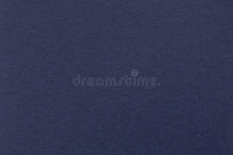 Struttura di carta blu scuro Fondo fotografia stock