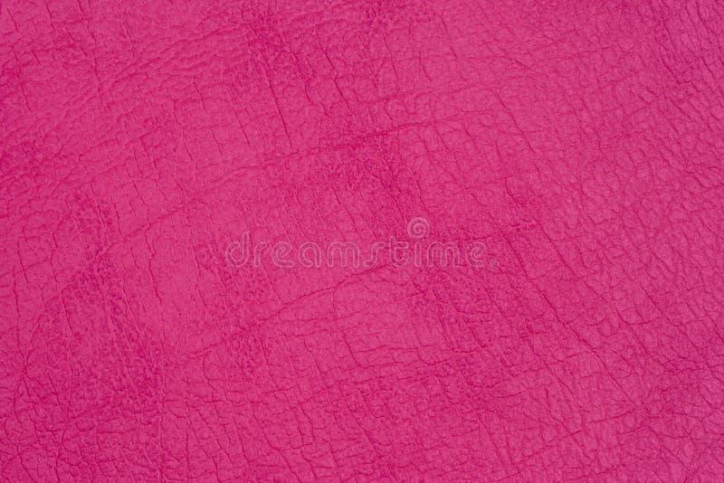 Struttura di cuoio genuina, rosa luminoso fotografia stock libera da diritti