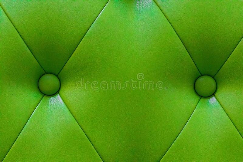 Struttura di cuoio verde elegante con i bottoni per il modello e il backg fotografia stock libera da diritti