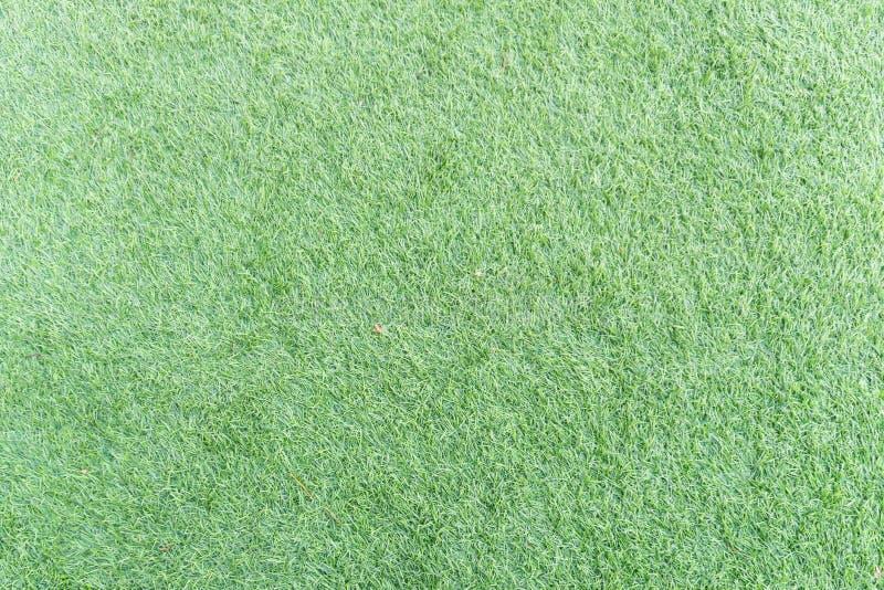 Struttura di erba artificiale verde intenso fotografia stock