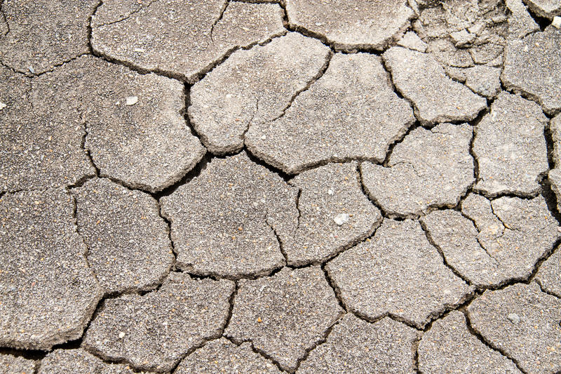 Struttura di fango con le crepe fotografie stock libere da diritti