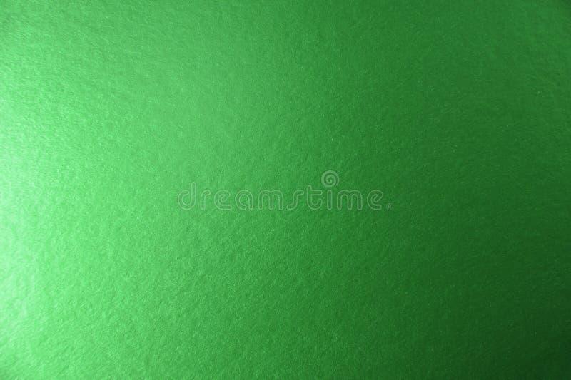 Struttura di fondo di carta metallico verde fotografia stock