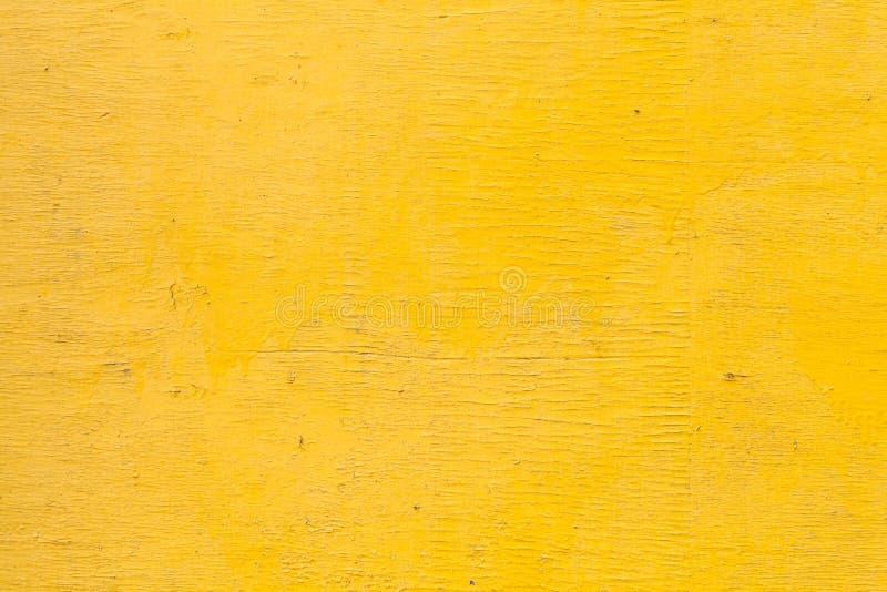Struttura di legno gialla luminosa della parete fotografia stock