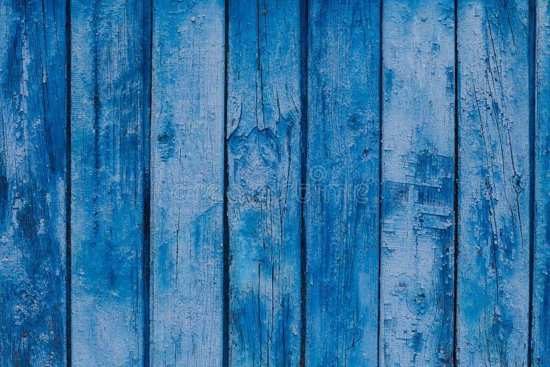 Struttura di legno Il fondo blu vecchio impallidisce i pannelli graffiati immagini stock