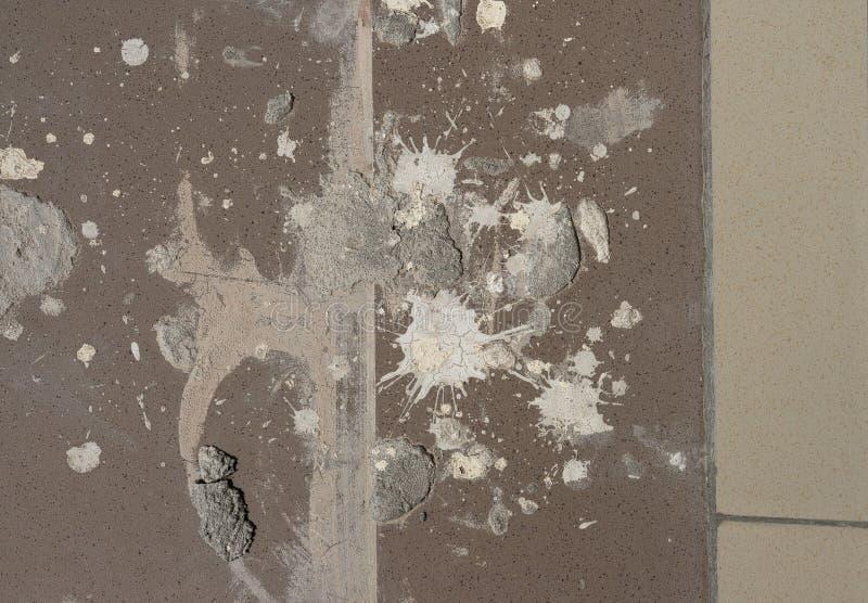 Struttura di lerciume - sporca spruzza di pittura e di gesso sui vecchi precedenti del pavimento per progettazione astratta, effe fotografie stock