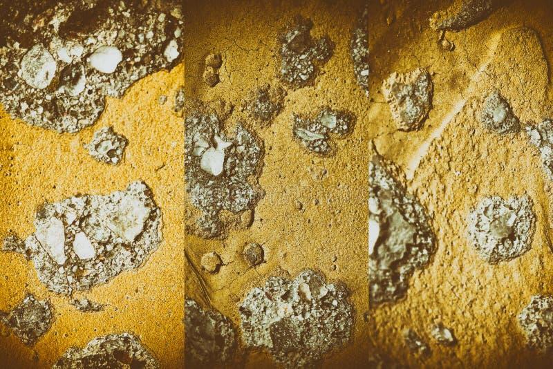 Struttura di Marte di gesso sulla parete, fondo incrinato, superficie della pietra immagine stock