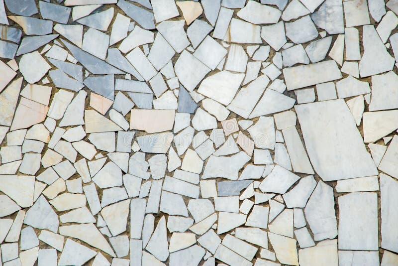 Struttura di mosaico di pietra astratta di marmo bianca e grigia come fondo fotografia stock