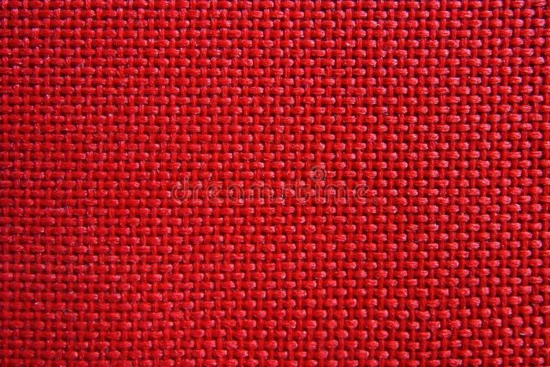 Struttura di nylon rossa del modello del tessuto immagini stock libere da diritti