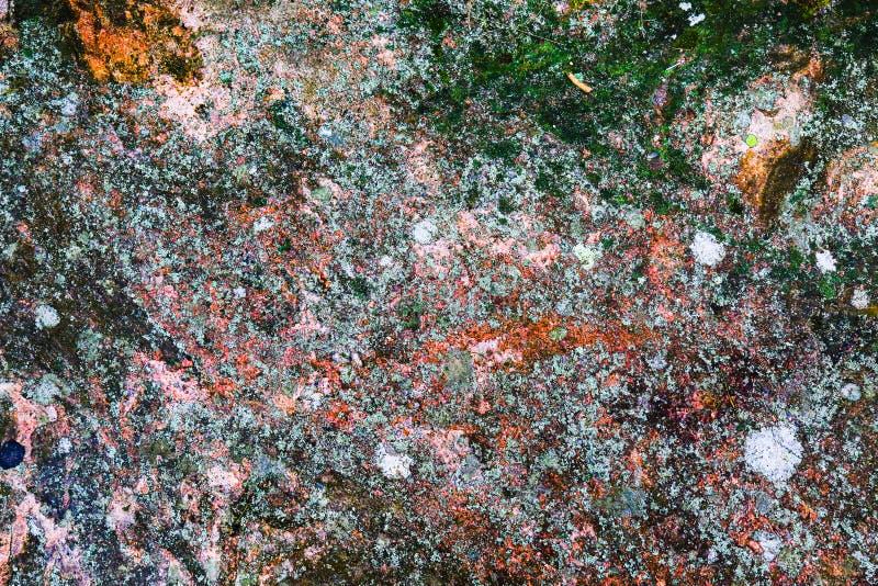 Struttura di pietra come fondo approssimativo di lerciume astratto con i colori chiazzati Superficie naturale del hard rock Vecch fotografia stock libera da diritti
