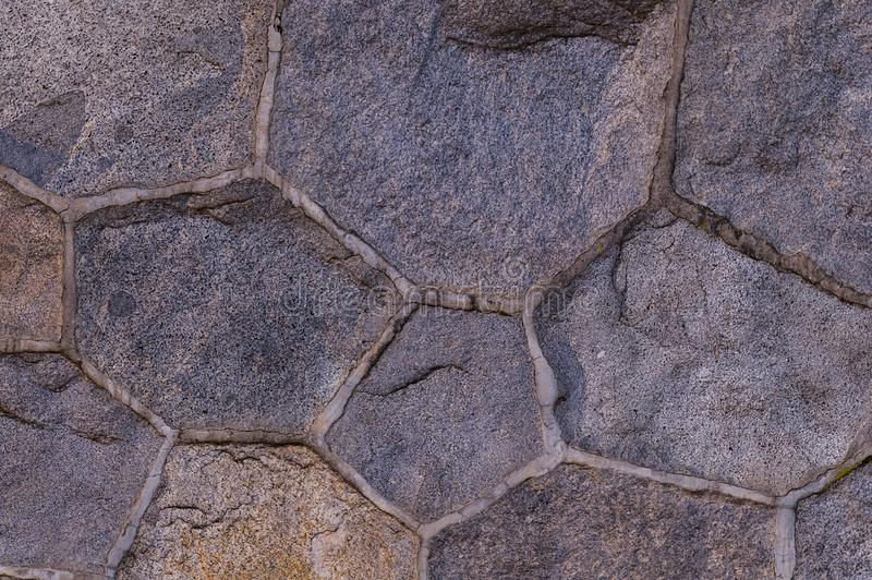 Struttura di pietra del granito del fondo fondo scuro complesso degli elementi della parete del ciottolo fotografie stock