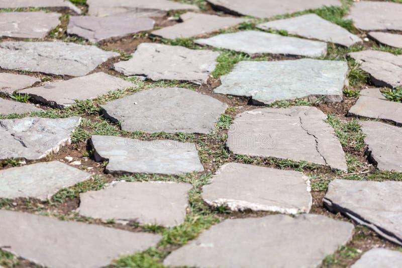 Struttura di pietra della pavimentazione Fondo astratto di vecchio ciottolo p immagine stock