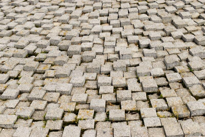 Struttura di pietra della pavimentazione Fondo della pavimentazione lapidato ciottolo del granito Fondo astratto di vecchio primo immagine stock