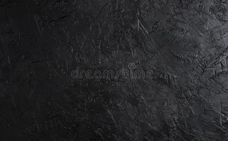 Struttura di pietra nera, fondo scuro dell'ardesia, vista superiore immagini stock
