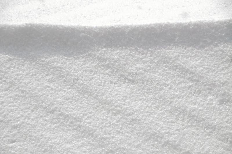 Struttura di superficie di Snowy in tempo soleggiato fotografia stock