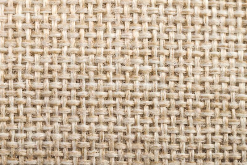 Struttura di tela del tessuto naturale per progettazione, tela di sacco strutturata bro fotografie stock libere da diritti