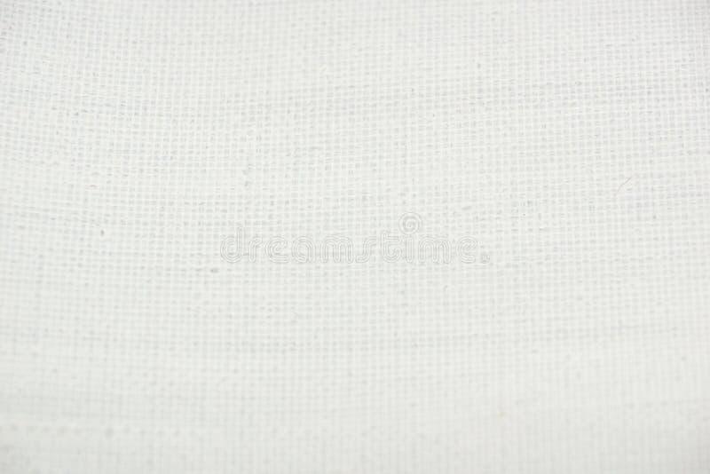 Struttura di tela innescata bianco immagini stock