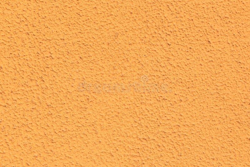 Struttura di un'arancia della parete Fondo poroso fotografie stock