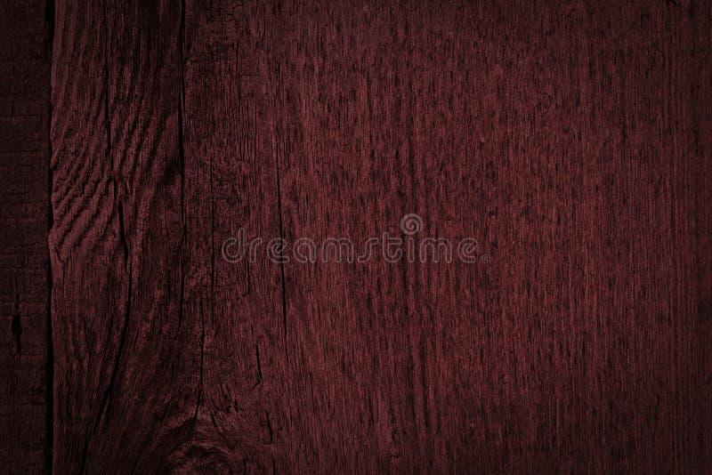 Struttura di vecchio legno ruvido scuro di Borgogna Fondo astratto di mogano per progettazione fotografia stock