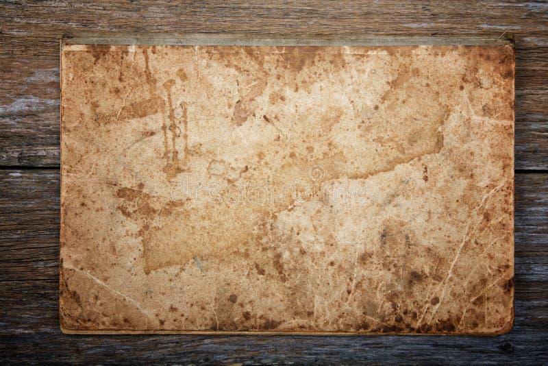 Struttura di vecchio scrittura-libro su un bordo fotografia stock