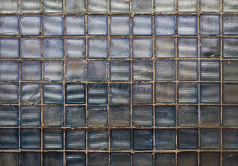 Struttura di vetro del vecchio blocco grungy ciano dall'URSS fotografia stock