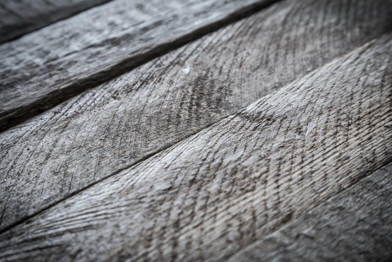 Struttura diagonale di legno grigia della plancia sottragga la priorità bassa fotografie stock libere da diritti