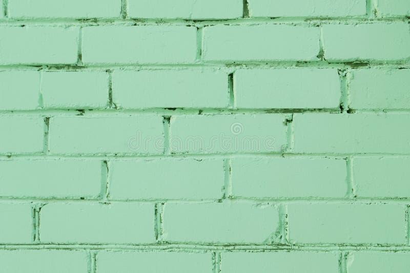 Struttura dipinta del muro di mattoni per fondo Colore verde pastello della menta neo dell'anno 2020 fotografie stock libere da diritti