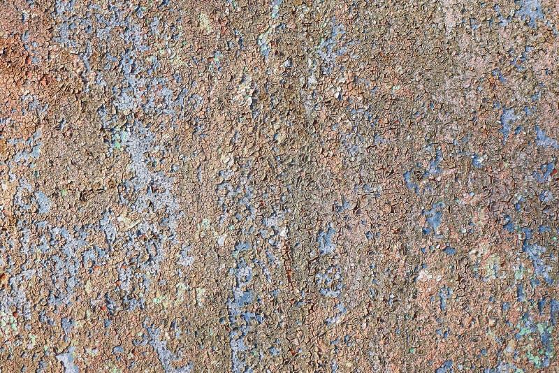 Struttura dipinta incrinata Vecchia pittura sbucciata sul fondo della parete fotografia stock libera da diritti