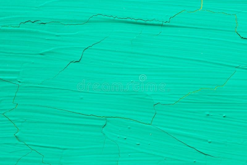Struttura dipinta incrinata verde del fondo immagine stock