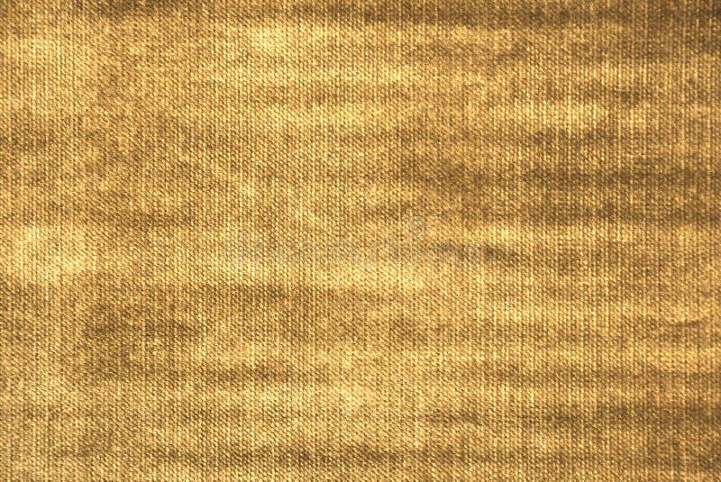 Struttura dorata del tessuto immagine stock libera da diritti
