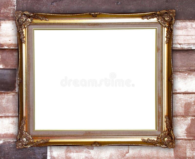 Struttura dorata sul fondo di legno della parete fotografia stock libera da diritti