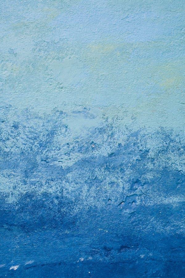 Struttura e fondo blu astratti per progettazione Vecchia parete dipinta nei blu navy e blu-chiaro immagine stock libera da diritti
