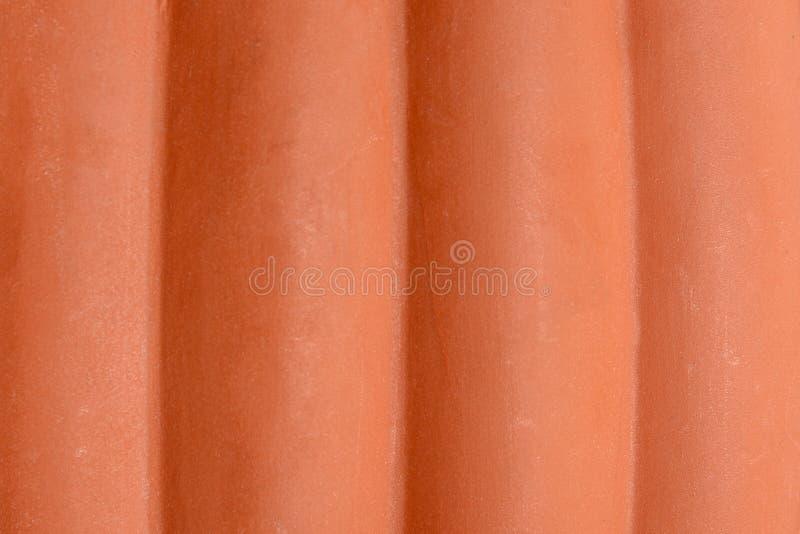Struttura eccellente di una forma cilindrica fatta di marrone di plastica immagine stock libera da diritti