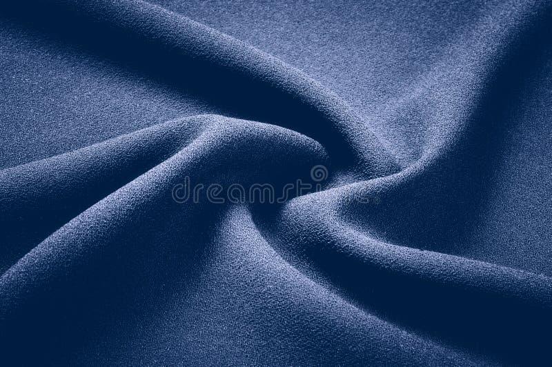 Struttura, fondo, modello Tessuto grigio con una latta blu pastello fotografia stock libera da diritti