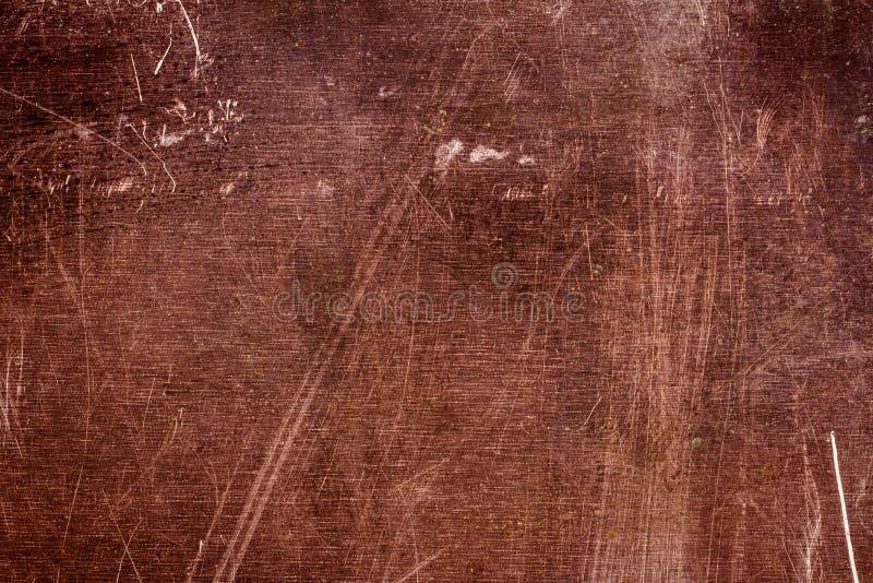 Struttura graffiata del piatto di rame, vecchio fondo del metallo fotografie stock