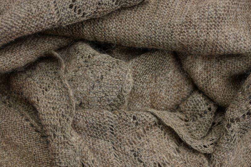 Struttura grigia da un frammento di vecchio scialle di lana immagine stock libera da diritti
