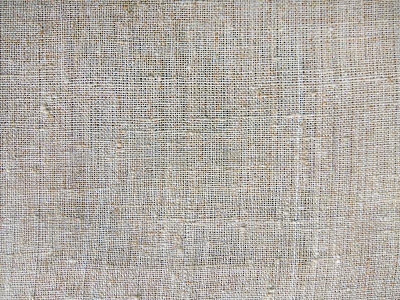 Struttura grigia del tessuto di cotone, fondo della tela immagini stock libere da diritti