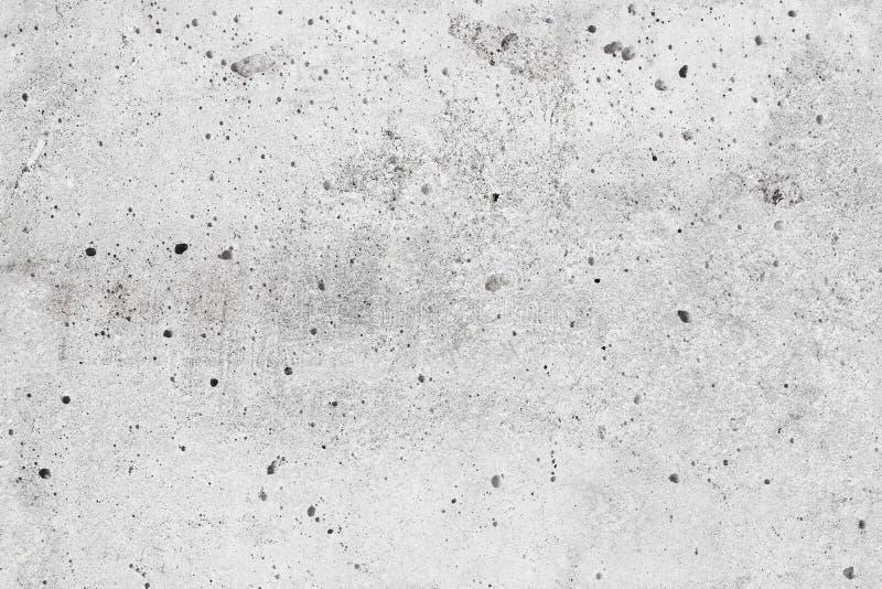 Struttura grigia senza cuciture del muro di cemento del primo piano fotografie stock