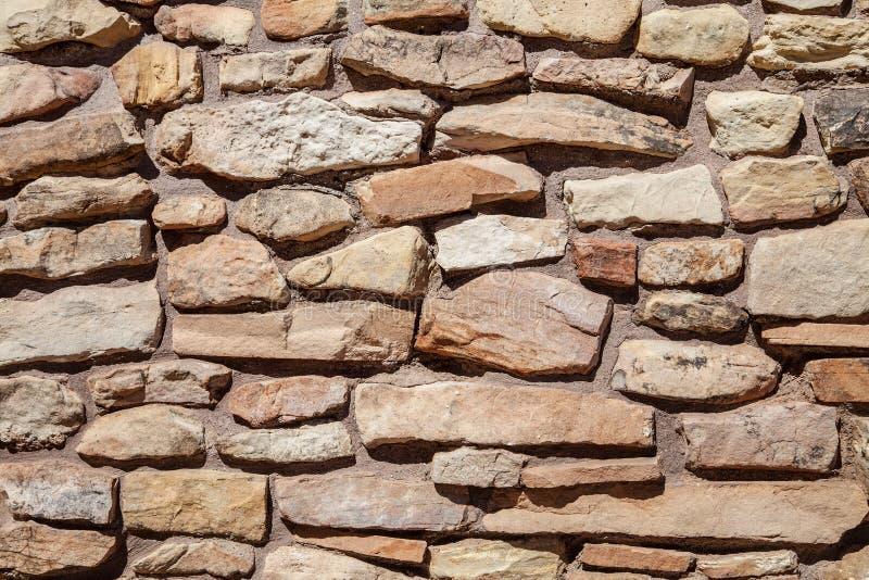 Struttura irregolare e immagine di sfondo della parete di pietra fotografia stock