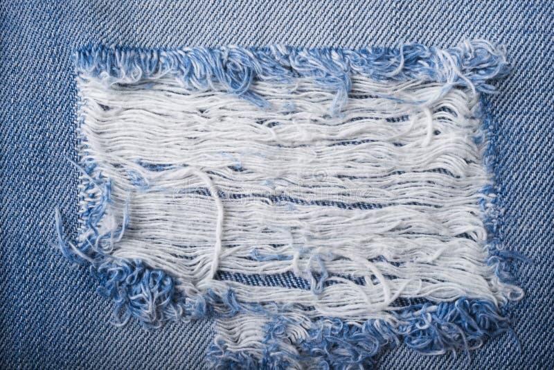 Struttura lacerata blu dei jeans del denim fotografia stock libera da diritti