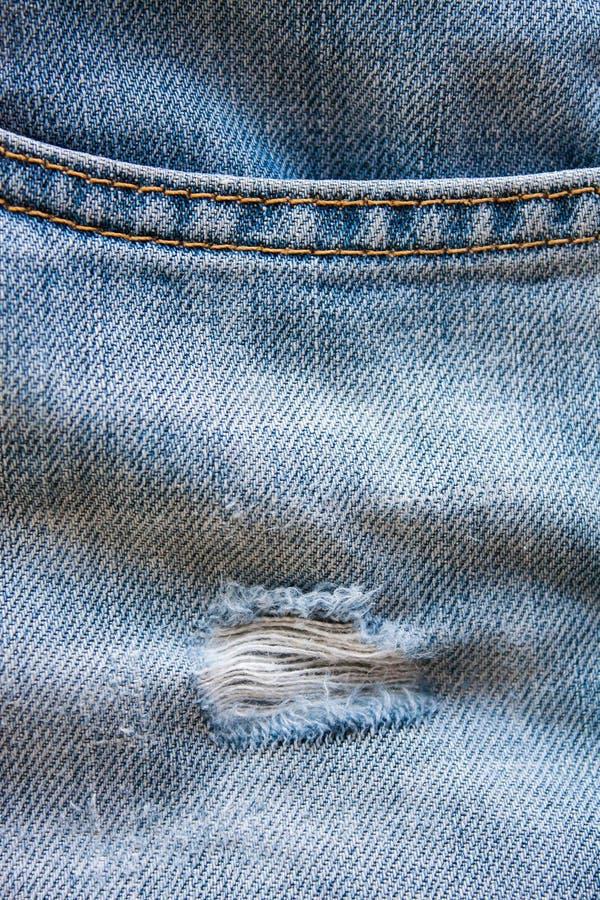 Struttura lacerata del denim dei jeans fotografia stock libera da diritti