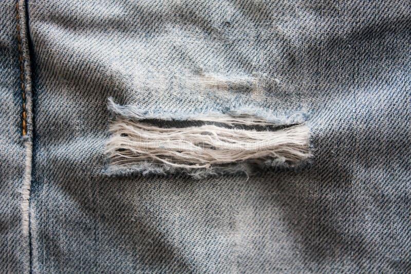 Struttura lacerata del denim dei jeans immagini stock