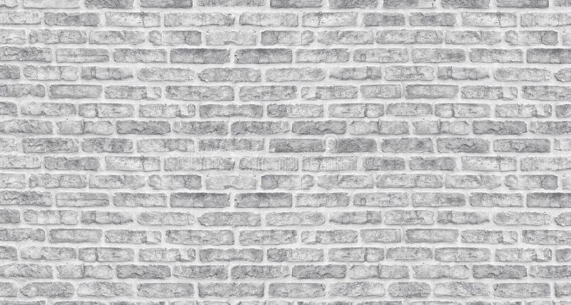 Struttura lavata bianca del muro di mattoni Muratura grigia ruvida Fondo d'annata imbiancato immagini stock libere da diritti