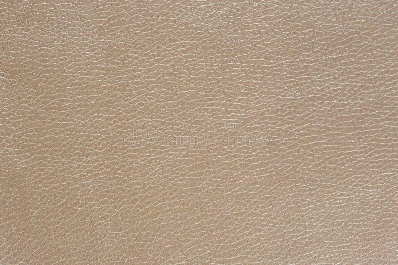 Struttura lucida beige del fondo del cuoio sintetico fotografie stock libere da diritti